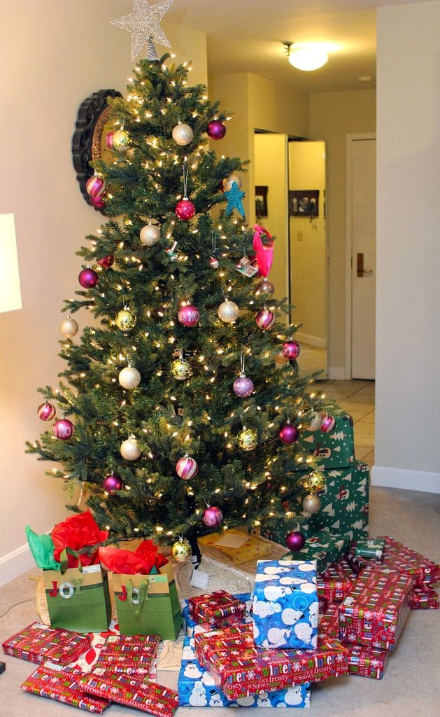 View of decorated Christmas tree with presents under it
