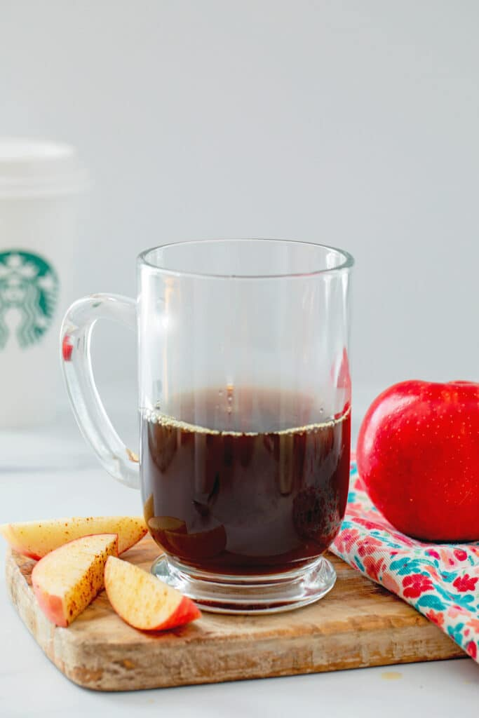 Head-on view of a coffee mug with apple brown sugar simple syrup and espresso