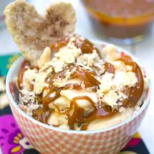 Apple Pie Ice Cream -- This Apple Pie Ice Cream has all the elements of your favorite seasonal treat: apple pie filling, apple cider caramel, and pie crust cookies. It will convince you to keep your ice cream machine out all fall and winter long | wearenotmartha.com