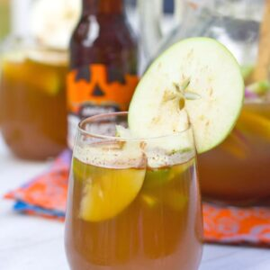 Apple Pumpkin Shandy Sangria -- Apple Pumpkin Shandy Sangria combines apple cider, pumpkin shandy beer, and apple brandy for a deliciously fall flavored apple sangria cocktail | wearenotmartha.com