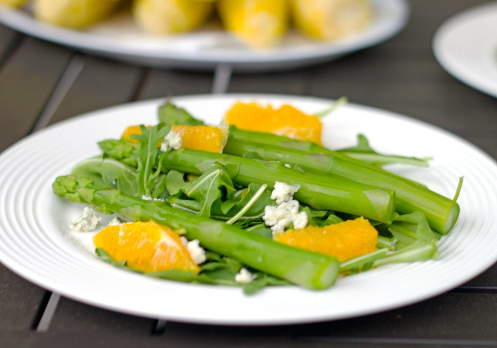 Landscape head-on view of asparagus salad with oranges and gorgonzola