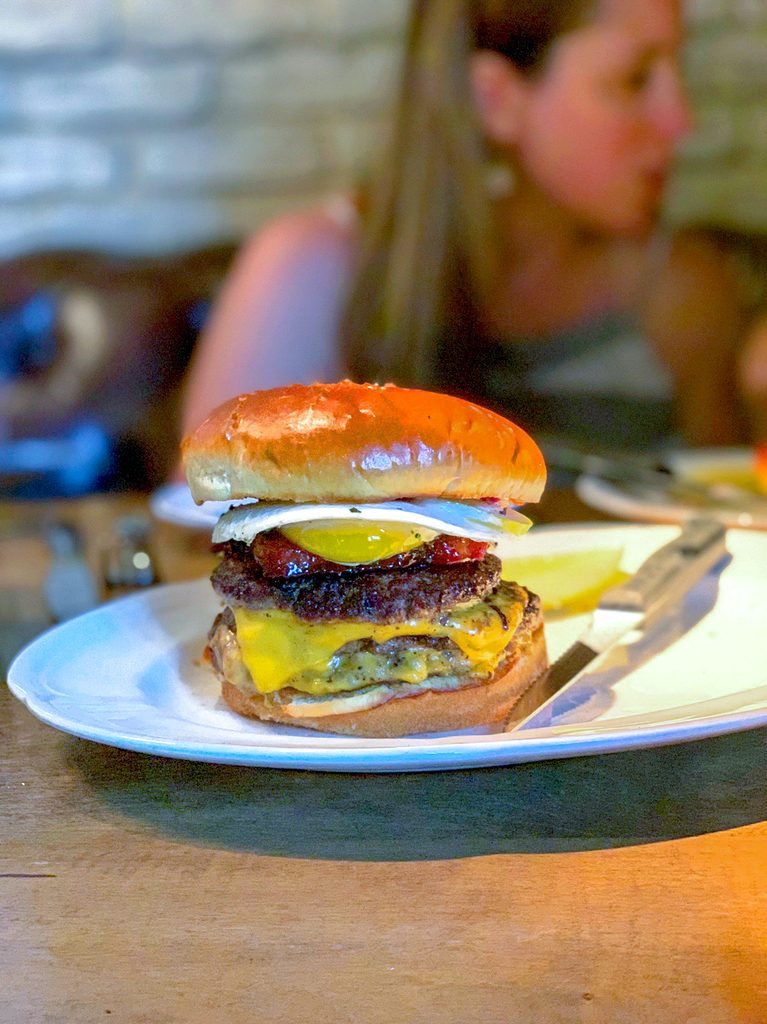 Head-on view of the double cheeseburger with bacon and egg from Au Cheval in Chicago