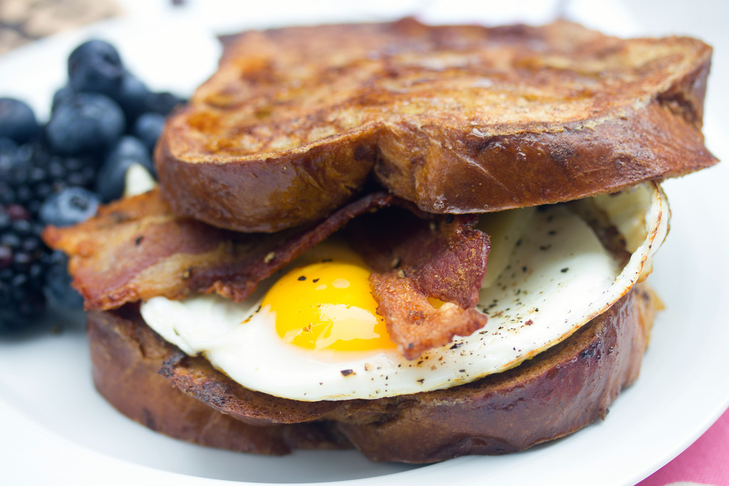 Autumn French Toast Egg Sandwich -- Bacon, eggs, cheese, and cinnamon spice on challah bread | wearenotmartha.com