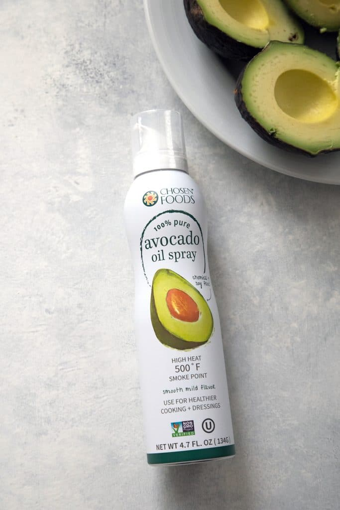 Grilled avocados sprayed with avocado oil spray before being turned into grilled guacamole | wearenotmartha.com