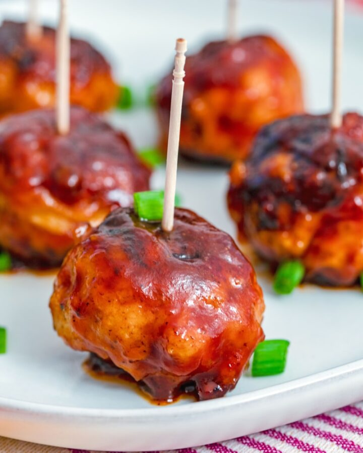 BBQ Chicken Meatballs -- These BBQ Chicken Meatballs are one of my favorite easy party appetizers, but they also make a delicious dinner when served with a couple veggie sides! | wearenotmartha.com