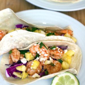BBQ Shrimp Tacos -- From the shrimp to the BBQ sauce to the pineapple, these BBQ Shrimp Tacos are the stuff summer dreams are made of! | wearenotmartha.com