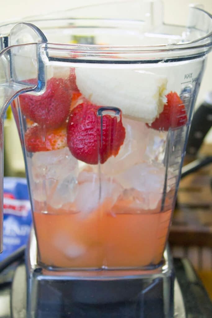 Strawberries, banana, ice, and Bacardi in a blender