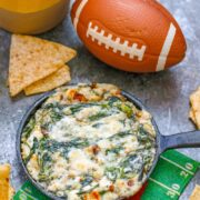 This Bacon Blue Cheese Spinach Dip can be made in individual skillets or a regular baking dish and is the perfect addition to your game day spread!