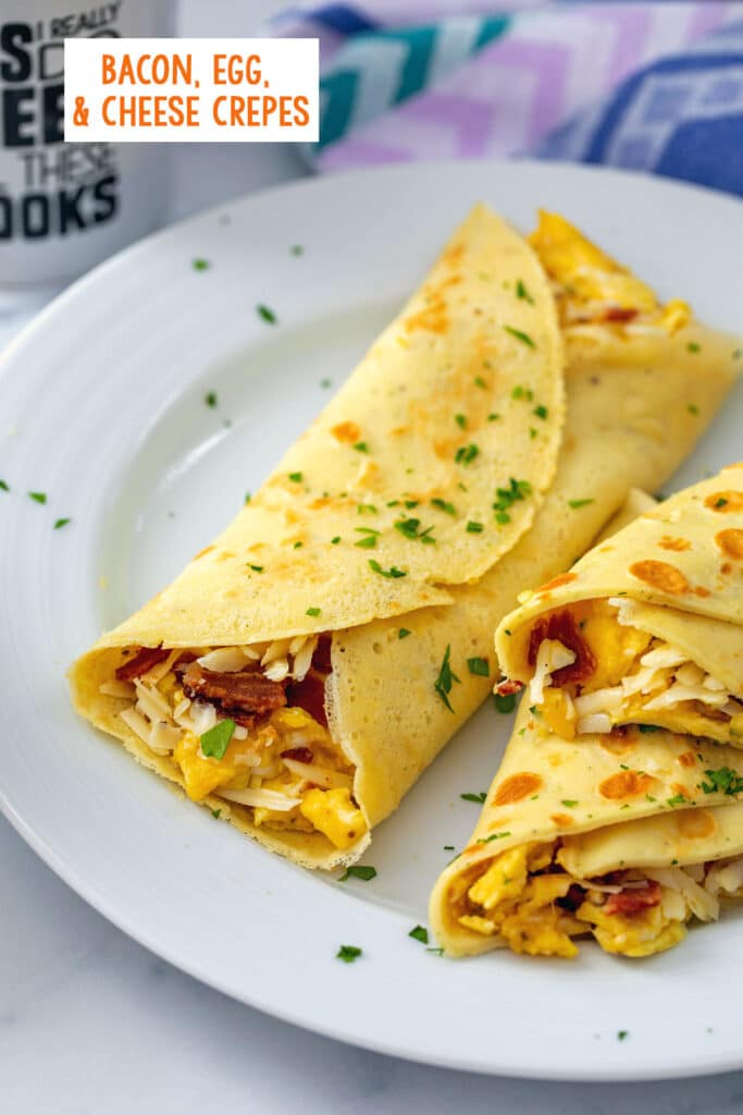 Overhead view of multiple bacon, egg, and cheese crepes on a white plate with parsley sprinkled over the top and recipe title at top