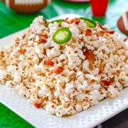 Bacon Jalapeño Cheddar Popcorn -- This Bacon Jalapeño Cheddar Popcorn is the perfect football watching party snack. It's a little bit spicy, a little bit cheesy, and packed with flavor | wearenotmartha.com