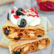 Baked Chicken Chimichangas -- Looking for an quick weeknight meal that's delicious and healthy? These Baked Chicken Chimichangas are easy to make and healthier than most Mexican food. Plus, they make a great freezer meal! | wearenotmartha.com