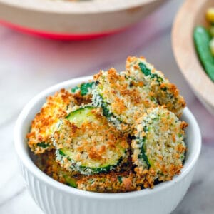 Baked Zucchini Chips -- What to do with all that summer zucchini? These Baked Zucchini Chips are deliciously flavorful and healthy and have the most satisfying crunch. Enjoy them as a side dish, snack, or salad topper! | wearenotmartha.com