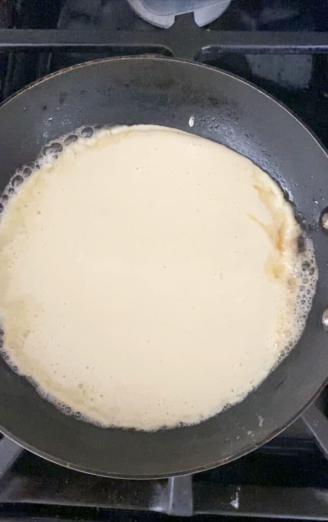 Crepe batter poured into small pan