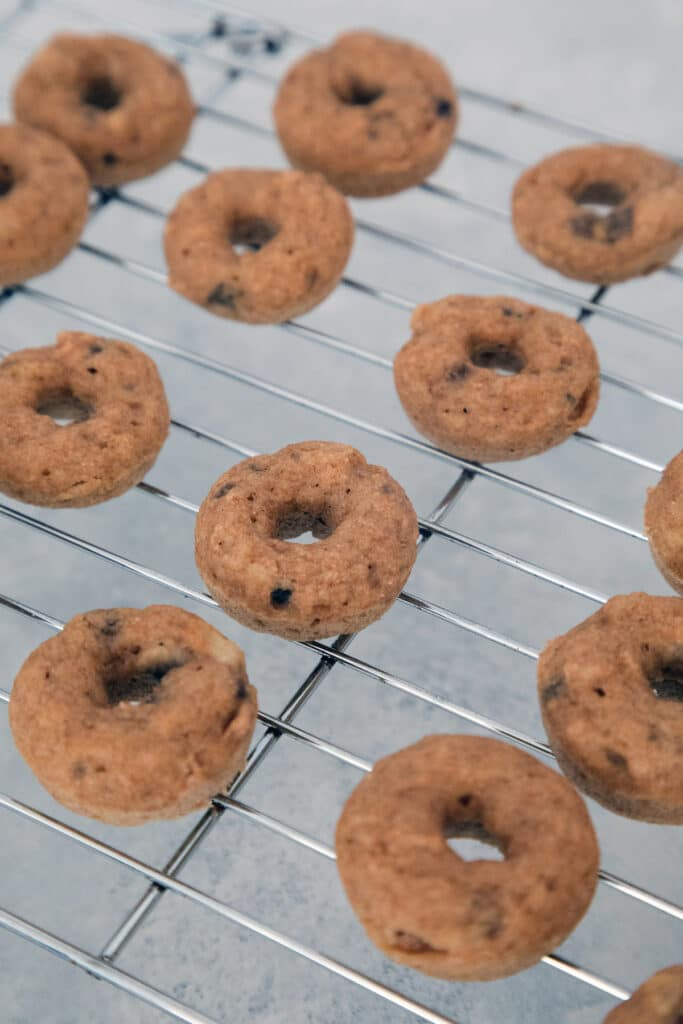 Mini donuts cooling on baking rack