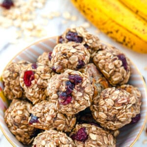 Banana Maple Cranberry Cookies -- These healthy Banana Maple Cranberry Cookies have a banana base and are packed with oats, flaxseed, applesauce, and dried cranberries. They're quick and easy to make and can double as dessert or breakfast! | wearenotmartha.com