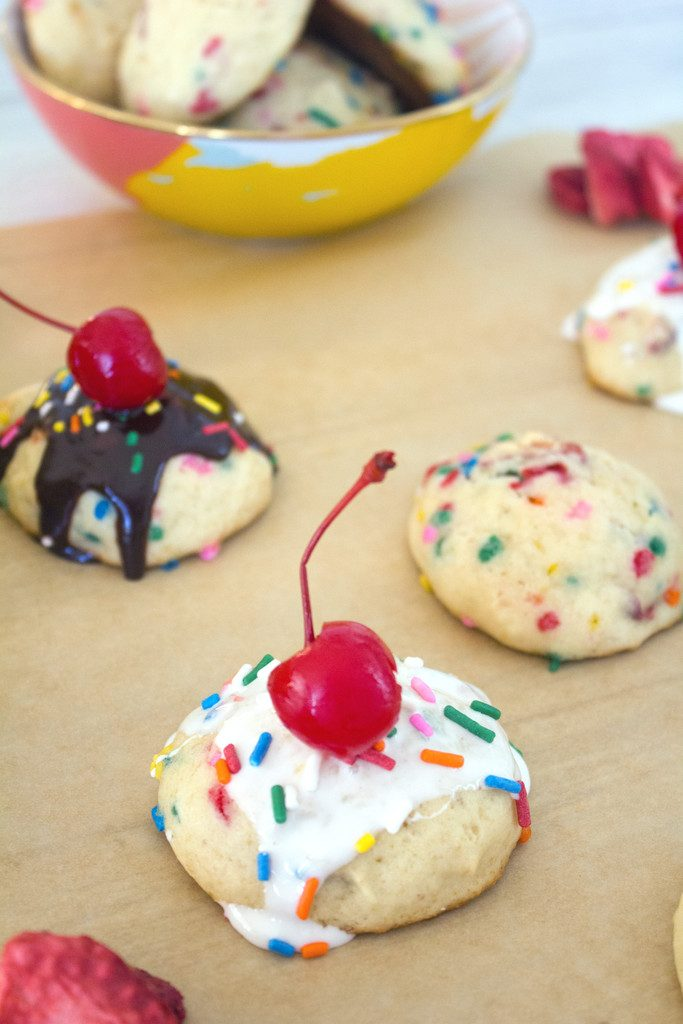 Banana Split Cookies -- Banana strawberry cookies with chocolate sauce, marshmallow, sprinkles, and a cherry on top! | wearenotmartha.com