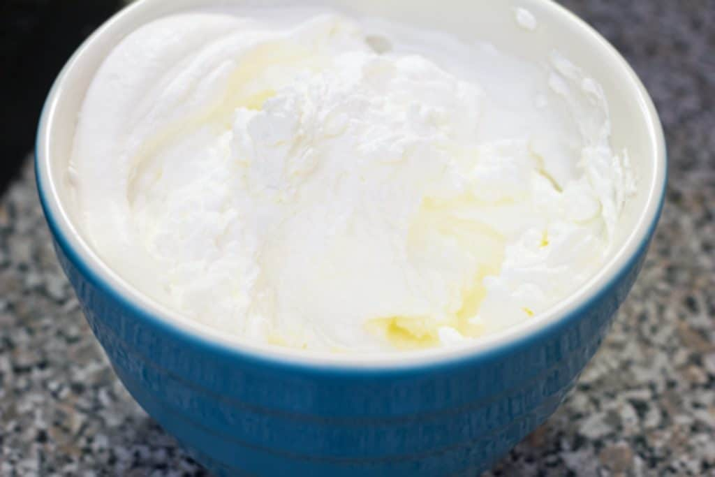 Bowl of whipped cream for topping Banana Split Vodka Milkshake