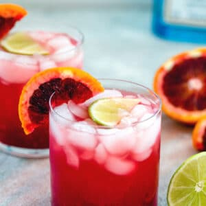 Blood Orange Gin Lime Rickey -- Searching for a delicious cocktail that's sure to brighten up your winter? I took a classic lime rickey drink and added fresh blood orange juice and gin for these blood orange gin cocktails! | wearenotmartha.com #gin #cocktails #gindrinks #bloodoranges #cocktails