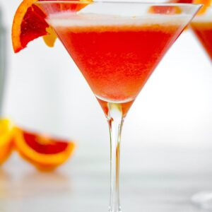 Blood Orange Meyer Lemon Gin Sour -- Winter citrus combines with gin and a little maple syrup for this Blood Orange Meyer Lemon Gin Sour. The vibrant color of a blood orange cocktail will always impress guests | wearenotmartha.com