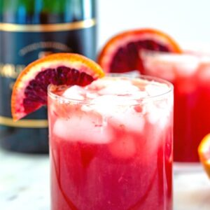 Blood Orange Sparkler -- This Blood Orange Sparkler is a simple blood orange cocktail with a splash of ginger ale and champagne. It's a lovely winter brunch cocktail, but can be enjoyed any time of day! | wearenotmartha.com