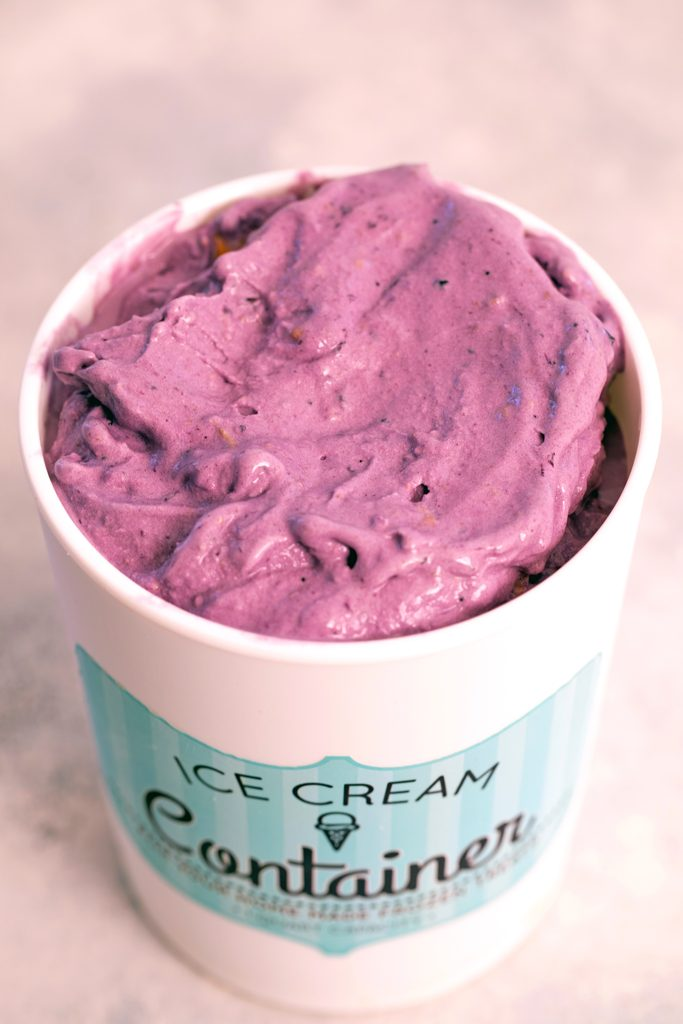 View of blueberry cheesecake ice cream in quart ice cream container