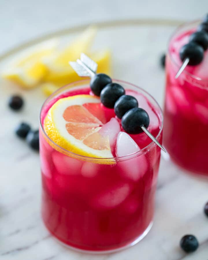 Blueberry Vodka Lemonade -- There's nothing quite like a glass of cold lemonade on a hot summer day. Unless it's a glass of cold Blueberry Vodka Lemonade! This summer cocktail is the perfect balance of tart and sweet and can also easily be made into a blueberry lemonade mocktail | wearenotmartha.com #vodka #lemonade #cocktail #blueberry #summer #mocktail