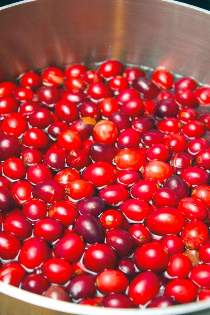 Cranberries simmering in saucepan