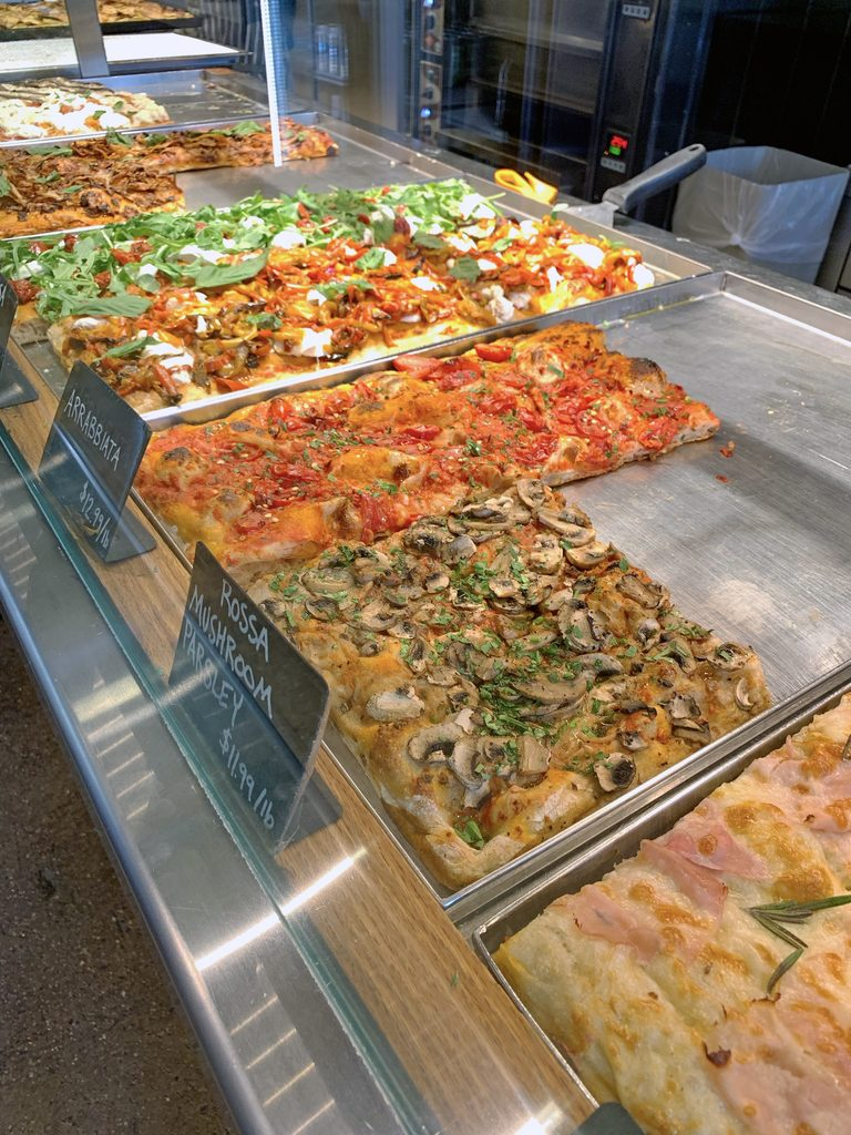 View of all of the various types of Italian style pizza at Bonci in Chicago