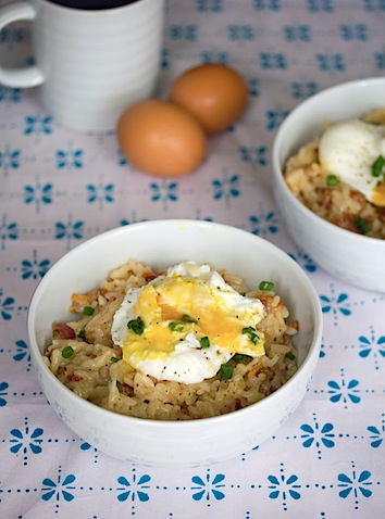 Breakfast Risotto with Bacon and Poached Eggs -- Though it's traditionally a dinner food, risotto can be enjoyed in the morning, too! This recipe for breakfast risotto combines bacon, eggs, and cheese for the ideal way to start your day   wearenotmartha.com