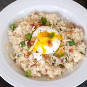 Breakfast Risotto -- Start your day with risotto made with bacon and cheddar cheese with a poached egg on top | wearenotmartha.com