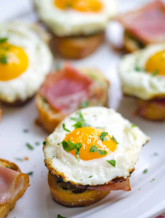 Brunch Bruschetta -- The perfect finger-food brunch dish to serve a crowd, these Brunch Bruschetta are topped with herbed garlic butter, prosciutto, and eggs | wearenotmartha.com