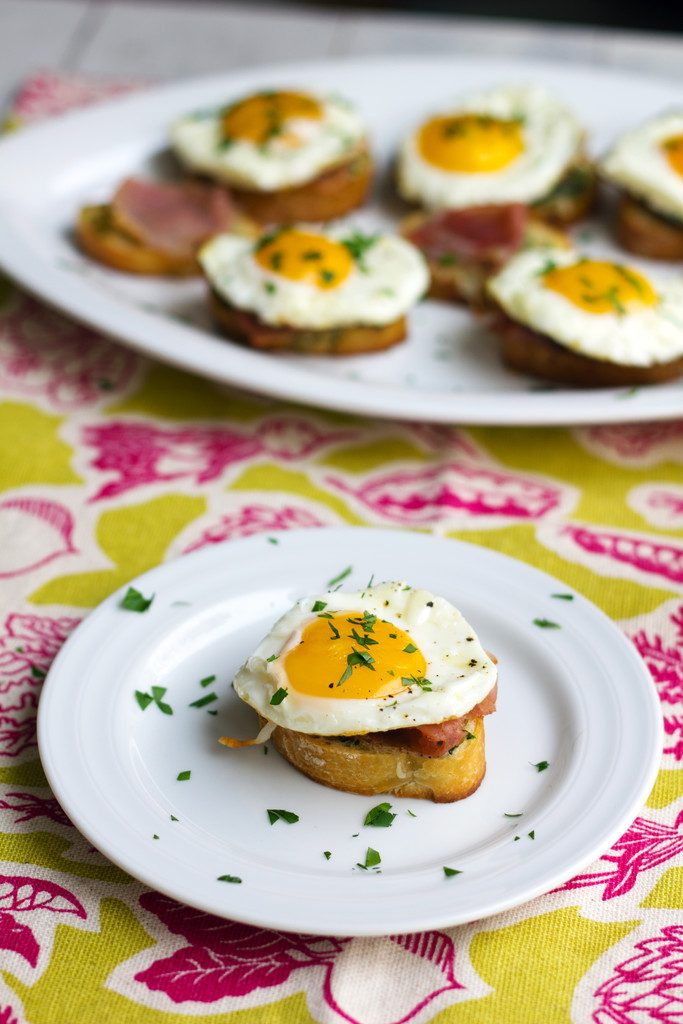 Brunch Bruschetta -- Toasts topped with parsley butter, prosciutto, and eggs | wearenotmartha.com