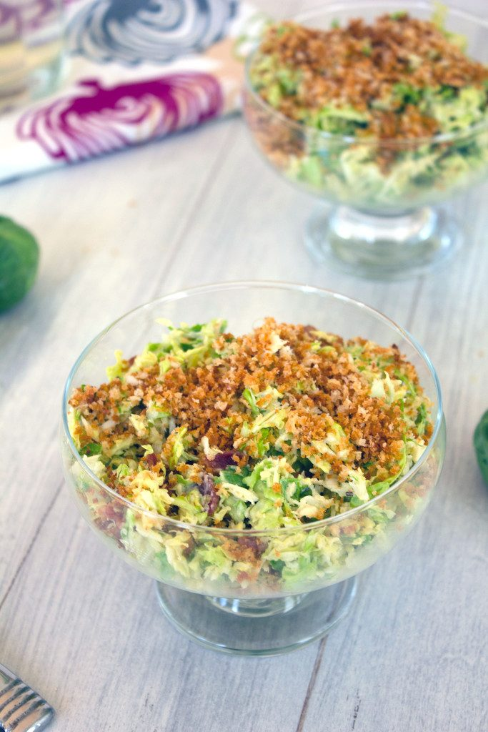 Brussels Sprouts and Bacon Caesar Salad -- the dish that will make you fall in love with brussels sprouts! | wearenotmartha.com