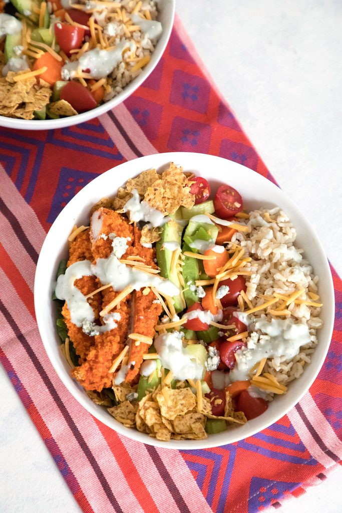 Buffalo Chicken Burrito Bowl -- This salad is packed with buffalo chicken, brown rice, avocado, tomato, and more | wearenotmartha.com