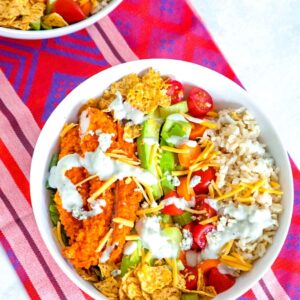 Buffalo Chicken Burrito Bowl -- This Buffalo Chicken Burrito Bowl is the ultimate salad with brown rice, avocado, carrots, celery, tomatoes, blue cheese dressing, and more. If you don't have time to make the whole entrée, you must at least make the buffalo chicken! | wearenotmartha.com