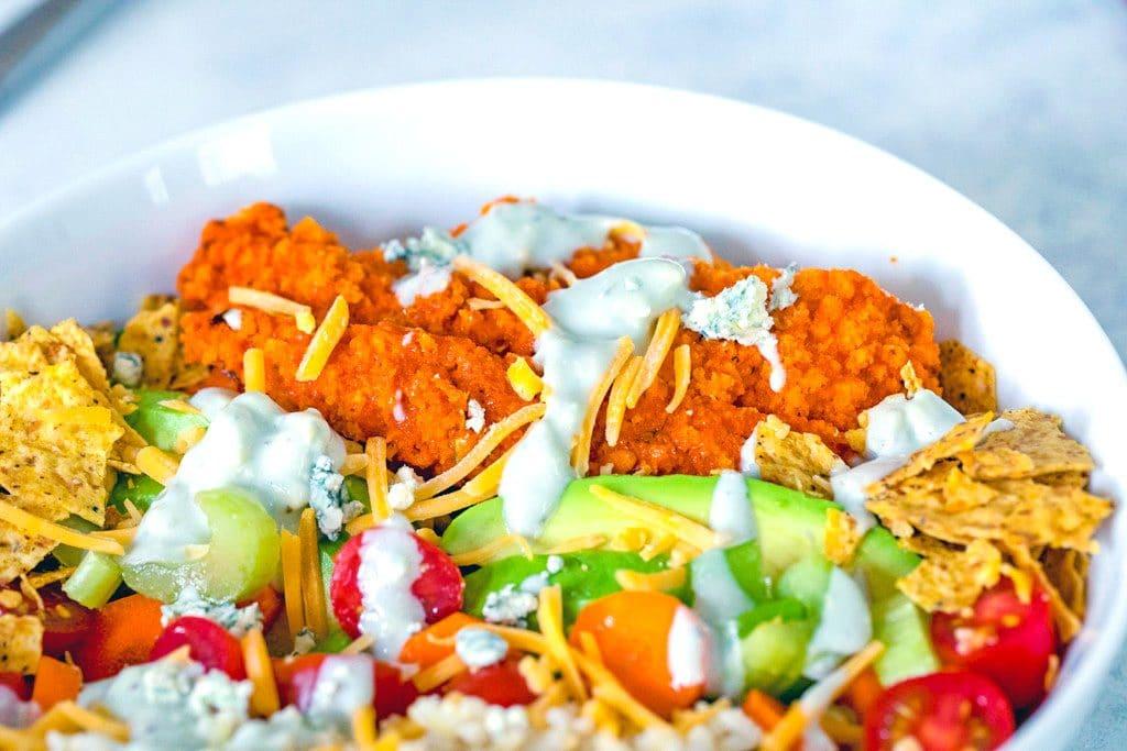 Landscape closeup view of buffalo chicken burrito bowl salad