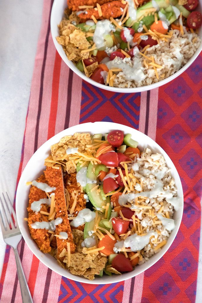 Buffalo Chicken Burrito Bowl -- This salad is packed with buffalo chicken, brown rice, avocado, tomato, and more   wearenotmartha.com