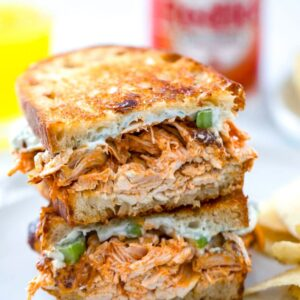 Buffalo Chicken Grilled Cheese -- Two of life's most delicious foods are combined into one perfect sandwich with this Buffalo Chicken Grilled Cheese. With a creamy blue cheese spread and plenty of spicy chicken and sharp cheddar cheese, you'll be craving this sandwich for both lunch and dinner | wearenotmartha.com