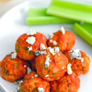 Buffalo Chicken Meatballs -- These Buffalo Chicken Meatballs are a little bit healthier than the typical buffalo wings, but with all the same flavor. They're perfect for football watching parties or any weekday dinner | wearenotmartha.com