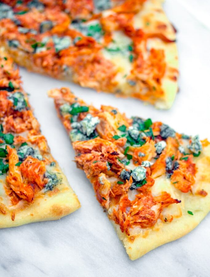 Buffalo Chicken Pizza -- If you love buffalo chicken and can't get enough pizza, you will be obsessed with this Buffalo Chicken Pizza. Make it with a rotisserie chicken for an incredibly easy weeknight dinner   wearenotmartha.com