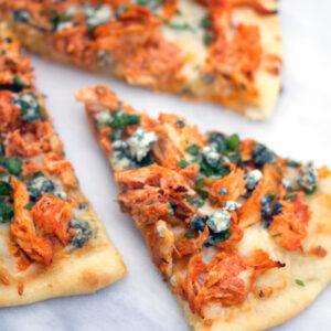 Buffalo Chicken Pizza -- If you love buffalo chicken and can't get enough pizza, you will be obsessed with this Buffalo Chicken Pizza. Make it with a rotisserie chicken for an incredibly easy weeknight dinner | wearenotmartha.com