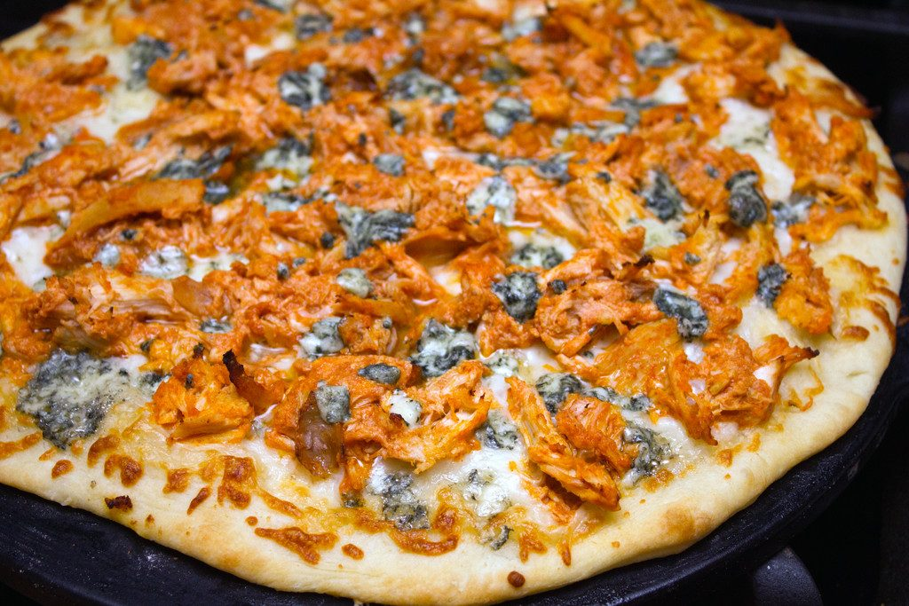 Buffalo chicken pizza on pizza pan right out of the oven
