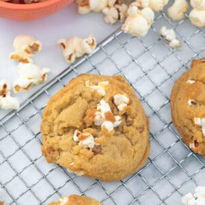 Closeup of a buttered popcorn cookie with popcorn all around