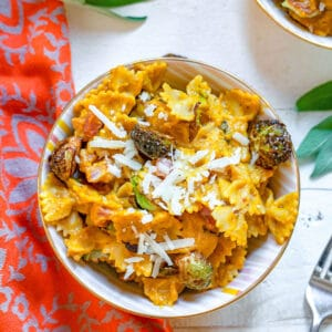 Take advantage of squash season with this deliciously creamy Butternut Squash Pasta with Fried Brussels Sprouts and Pancetta. The pasta dish is packed with goodness and is the kind of dinner your whole family will love (even if they think they don't like brussels sprouts!).