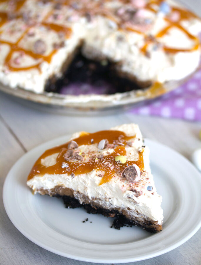 Cadbury Creme Egg Chocolate Cream Pie -- It wouldn't be Easter if you didn't indulge in a Cadbury Creme Egg or Cadbury Mini Eggs. You can enjoy both (plus a whole other lot of goodness!) in this Cadbury Creme Egg Chocolate Cream Pie | wearenotmartha.com
