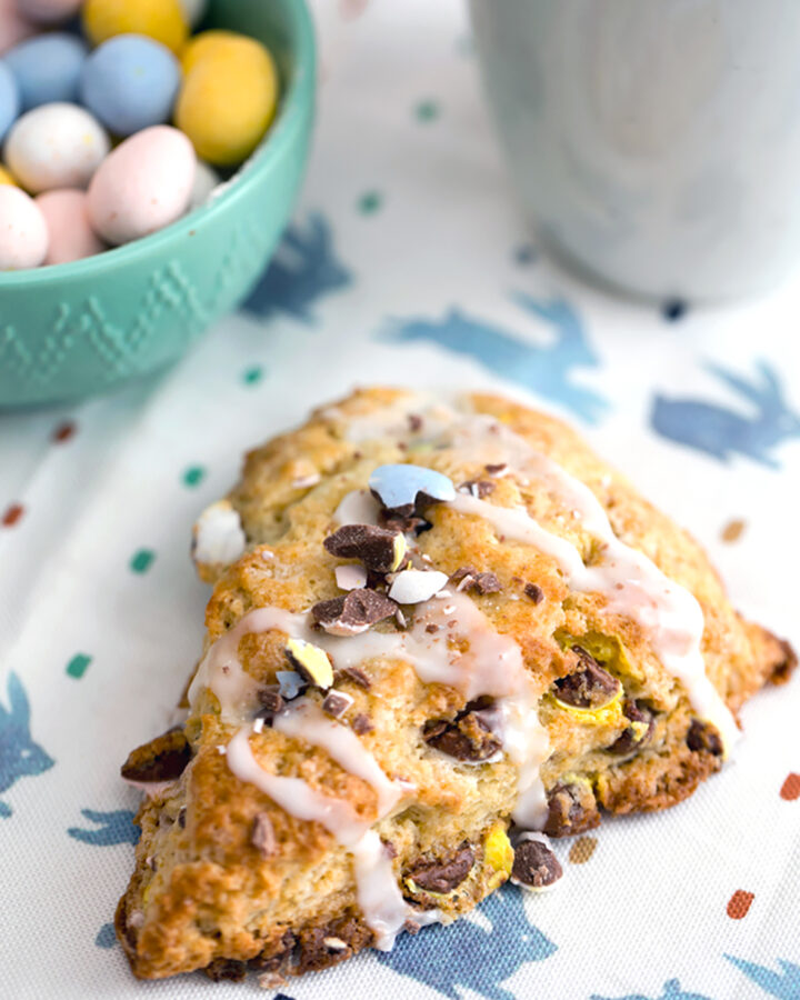Head-on view of Cadbury Mini Egg Scone topped with icing drizzle and crushed Cadbury Mini Eggs