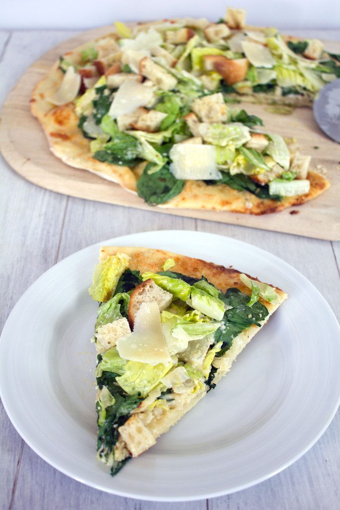 Caesar Salad Pizza -- Thin crust pizza topped with Caesar salad, cheese, and baby spinach   wearenotmartha.com