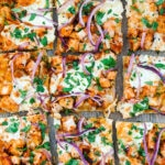 BBQ Chicken Pizza -- This pizza is inspired by a menu favorite from California Pizza Kitchen. With simple ingredients and a homemade crust (or store-bought if you want!), this copycat pizza can easily be made and enjoyed at home | wearenotmartha.com