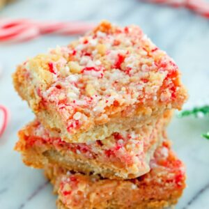 These simple shortbread bars are packed with holiday flavor thanks to candy canes. Candy Cane Crumble Bars make a fabulous addition to your holiday cookie platters!