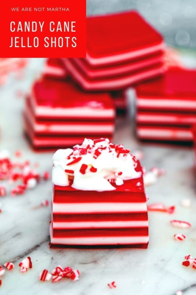 These easy to make Candy Cane Jello Shots are always a welcome treat at any Christmas party! #boozytreats #jelloshots #candycanedesserts #peppermintdesserts #jello